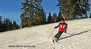'Skiing is the meaning of Kitzbühel's high life' from the web at 'http://www.tourmycountry.com/austria/../graphics/skiing-piste.jpg'