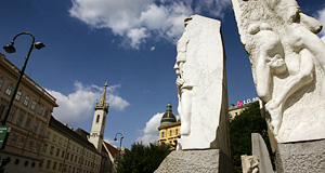 The Augustinerkirche or Augustinian Church in Vienna in the background of Alfred Hrdlicka's anti-war and anti-Fascism memorial